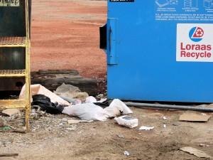 garbage outside recycling bin