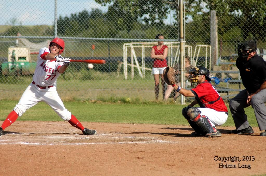 Rosetown Angel batter, Regan L'Heureux catcher for Cardinals, Adolph Fischer umpire